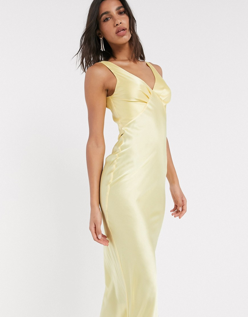 Желтое платье-комбинация миди на бретелях